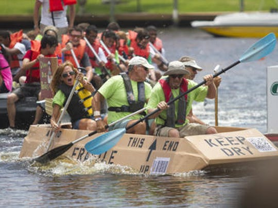 The Grumpy Old Boaters edge out FGCU in their race at the annual Cape Coral Cardboard Boat Regatta.