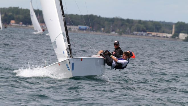 Douglas Wake, 15, of Sheboygan Falls is pictured at the helm, Noah Bartelt, 14, of Sheboygan is hiking and Isabelle Berger, 16 of Sheboygan is midship during a recent race. The area trio competed in the Lightning Class Junior North American's and placed second.