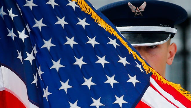 An Air Force ROTC member presents the US flag during the national anthem as the University of Delaware holds its 168th Commencement, honoring 5883 undergraduate and graduate degree recipients Saturday, May 27, 2017 at Delaware Stadium.