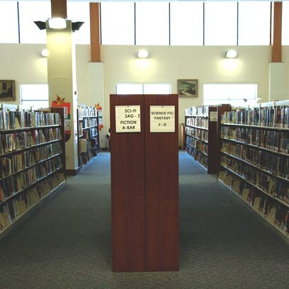 Rows of books at the Lester Public Library in Two Rivers.