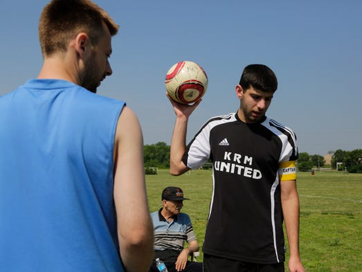 At left, Emir Salinovic from Bosnia, and Ahmed Kassim, right, warm up for a game on River Road. June 1, 2014