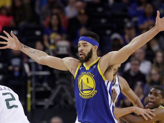 In this March 25, 2018, photo, Golden State Warriors center JaVale McGee (1) guards Utah Jazz forward Joe Ingles during an NBA basketball game in Oakland, Calif. From executives and scouts to coaches and analytics types, teams are paying closer attention to wingspan when considering players _ especially with what long arms can mean making a defensive impact. (AP Photo/Jeff Chiu)