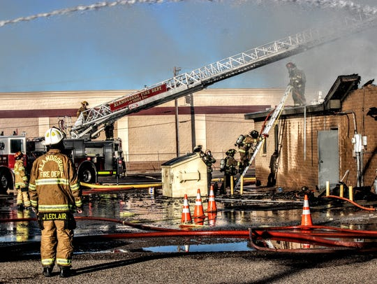 Alamogordo Fire Department Chief Jim LeClair directs AFD firefighters during the Emmanuel's Grill fire Saturday morning.