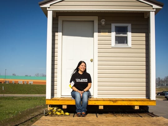 Sherry Nicholson with one of the finished micro-homes in Nashville.