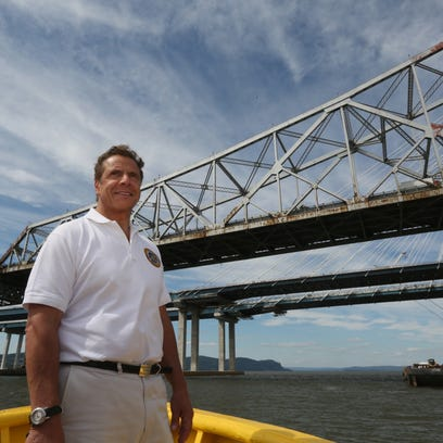 Go. Andrew Cuomo views the Tappan Zee Bridge and the