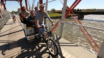 Watch an Iowa band perform on the back of a bike taxi