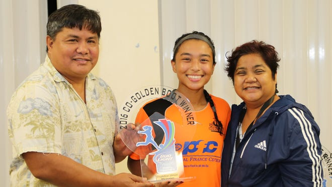 Personal Finance Center Lady Crushers' Skyylerblu Johnson accepts the 2016 Bud Light Women's Futsal League Golden Boot trophy from Guam Football Association General Secretary Tino San Gil Sunday evening in an awards ceremony following the league's championship match at the GFA National Training Center. Johnson tied with teammate Anjelica Perez in the Golden Boot race, scoring 12 goals in the regular season. In the photo are, from left to right, San Gil, Johnson, and GFA Women's Administrator Grace Martinez.