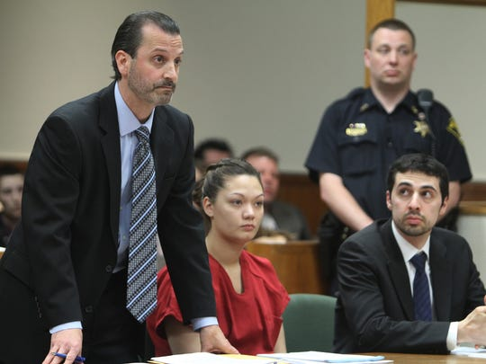 Matthew Parrinello  with Dawn Nguyen and attorney Mark Foti beside them, asks the judge to change some of the wording in a document before asking for leniency.