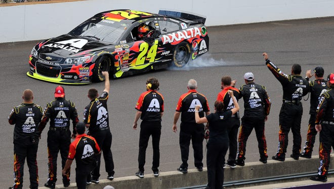 Jeff Gordon celebrates in front of his crew after winning the NASCAR Brickyard 400 auto race at Indianapolis Motor Speedway in Indianapolis, Sunday, July 27, 2014.