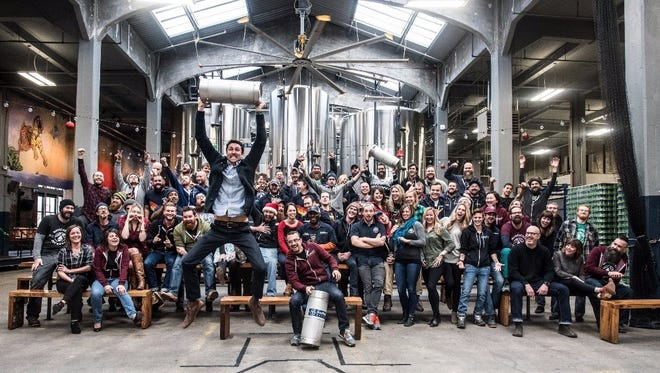 Rhinegeist staffers inside their Over-the-Rhine brewery.