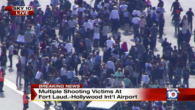 In this still image from video provided by NBC TV Local10, people stand on the tarmac after shots were fired at the international airport in Fort Lauderdale, Fla., on Jan. 6, 2017.