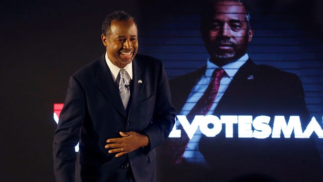 Republican presidential candidate Ben Carson smiles at the audience Friday, Jan 22, 2016, as he takes his seat for BET's #AllVotesMatter event at Drake University in Des Moines.
