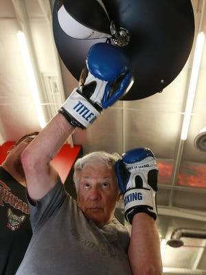Arvin Robinson punches a speed bag during the Rock Steady Parkinson's Boxing Class at MOVE Steady Training Center. Robinson, 77, was diagnosed with Parkinson's disease five years ago.
