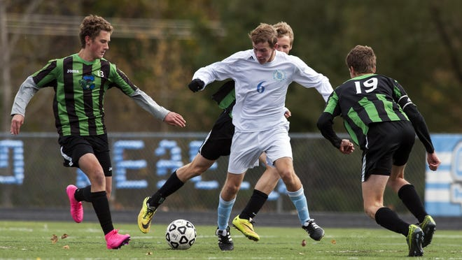 South Burlington's Patrick O'Hara (6) and Colchester's Tyler Cirillo (13) battle for the ball during the boys quarterfinal playoff game between the Colchester Lakers and the South Burlington Rebels at South Burlington High School in 2015.