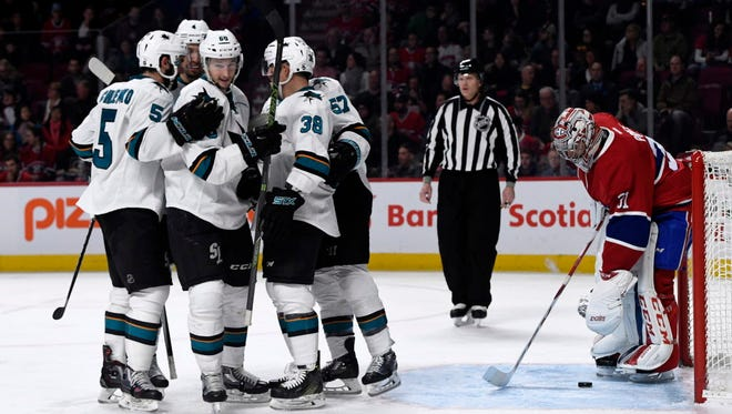 Sharks forward Melker Karlsson (68) reacts with teammates after scoring a goal against the Canadiens' Carey Price.