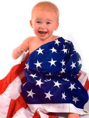 Baby and flag of USA