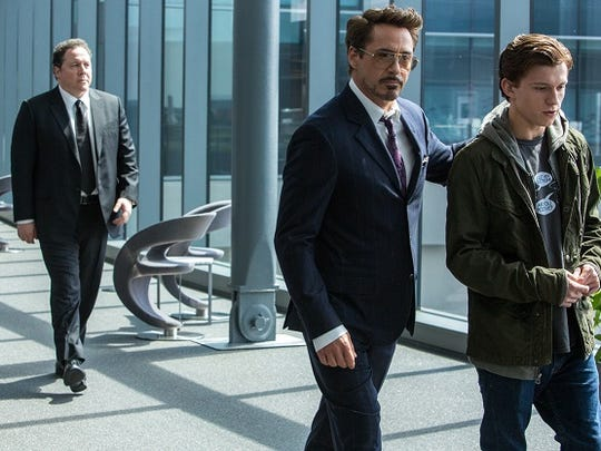 Jon Favreau, left, Robert Downey Jr, middle, and Tom Holland right, star in 'Spider-Man: Homecoming.'