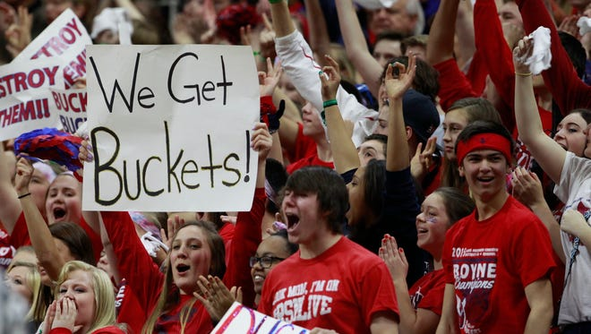 Fans cheer at an MHSAA boys basketball Class C semifinal March 26, 2015, in East Lansing.