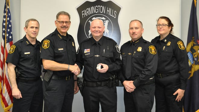 Farmington Hills Police Assistant Chief Michael Ciaramitaro (left), Chief Charles Nebus, Sgt. Chad Double, Assistant Chief Jeff King and Commander Bonnie Unruh.