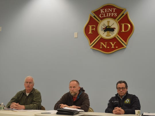 Fire District Chairman Doug Casey,. left, urged the