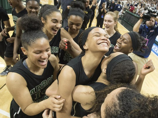 Ypsilanti Arbor Prep players, including high scorer Nastassja Chambers, celebrate their Class C championship at Breslin Center.