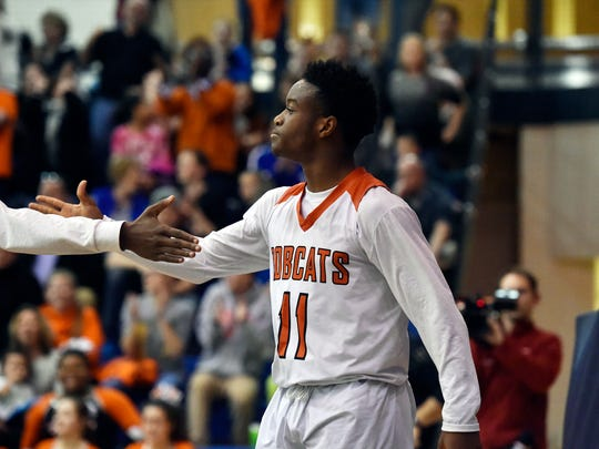 Northeastern's Fred Mulbah, center, greets teammate Austin Greene in the last few minutes of the second half of a second-round PIAA Class 5A boys' basketball game Thursday, March 16, 2017, at Manheim Township. Northeastern defeated Upper Merion 61-40 to advance to the quarterfinals.