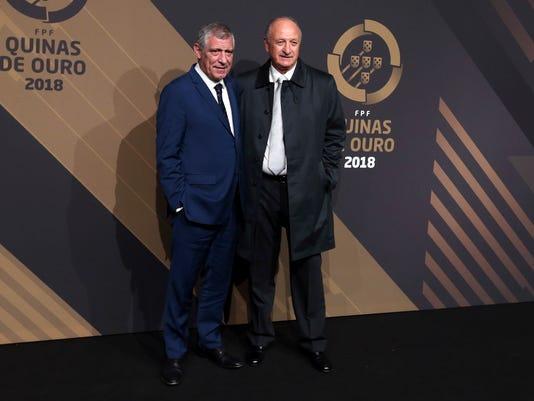 Portugal national team coach Fernando Santos and Brazilian coach Luis Felipe Scolari, right, arrive for the Portuguese soccer federation awards ceremony Monday, March 19, 2018, in Lisbon. (AP Photo/Armando Franca)