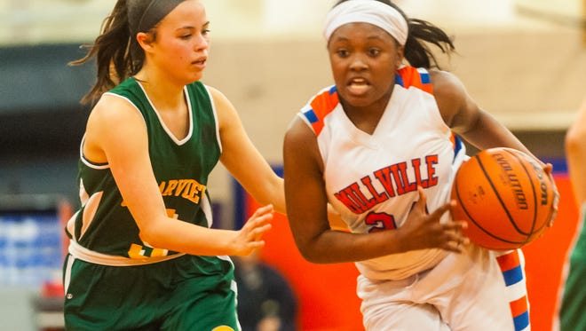 Millville's Tanazha Ford (24) drives to the basket against Clearview in a game from last season. Ford is a veteran on the Thunderbolts' roster this winter.
