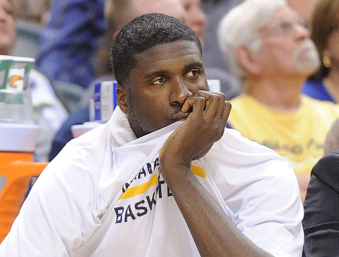 Roy Hibbert watches from the bench as the Pacers trail Atlanta by more than 30 points in the first half. The Hawks trounced the Pacers 107-88.