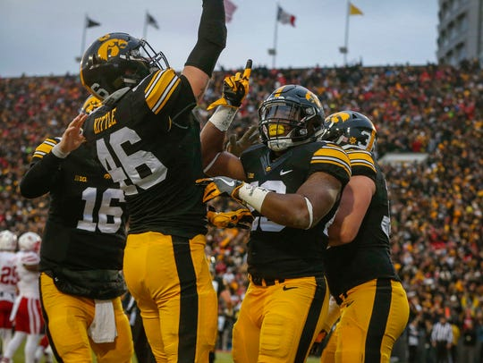 Members of the Iowa Hawkeyes offense celebrate after