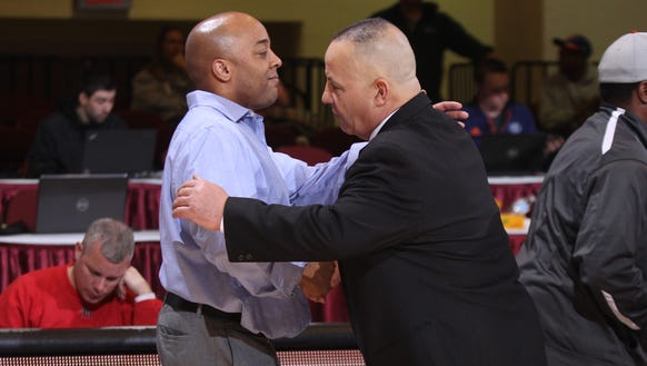 North Salem athletic director and boys basketball coach Henry Sassone (right) is one of several championship committee members who resigned this week.