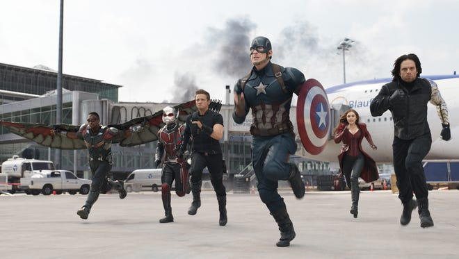 Falcon (Anthony Mackie, left), Ant-Man (Paul Rudd), Hawkeye (Jeremy Renner), Captain America (Chris Evans), Scarlet Witch (Elizabeth Olsen), and Winter Soldier (Sebastian Stan) race into battle against Iron Man's team in 'Captain America: Civil War.'
