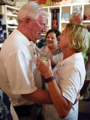 State Rep. Charles Sargent, R-Franklin, is greeted by his wife Nancy at Puckett's Grocery & Restaurant in Franklin on Aug. 4, 2016.