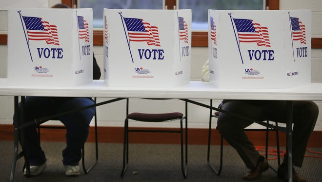 Voters mark their ballots during an election.