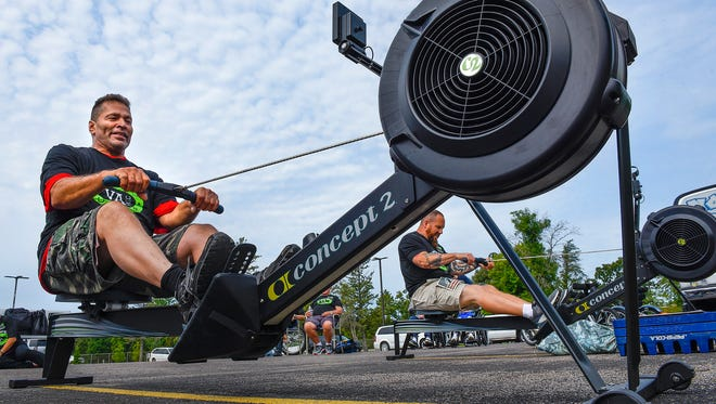 John Lopez, left, competes against Aaron Grahme in the 1,000-meter rowing event during the Veteran Summer Games Saturday, Aug. 5, at the St. Cloud VA Health Care System