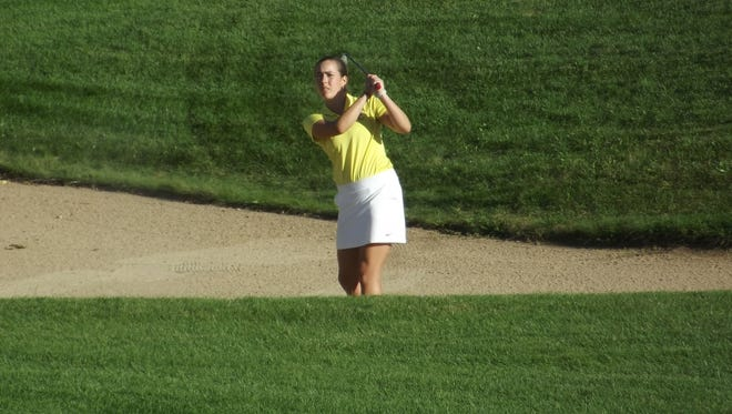 Green Bay Preble senior Katie Warpinski works her way out of a bunker with a shot onto the green of a par-4 hole at Thornberry Creek at Oneida on Wednesday in a Fox River Classic Conference meet.