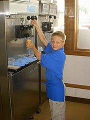 Hunter Gutwein in his family's ice cream shop in the early 2000s.