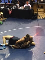 Oak Harbor's Dylan Thorp, top, competes at the AAU Scholastic Duals wrestling tournament.