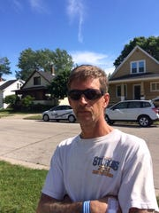 James Williams, a neighbor on Reber Street who helped save a woman and her child from two pit bulls Monday.