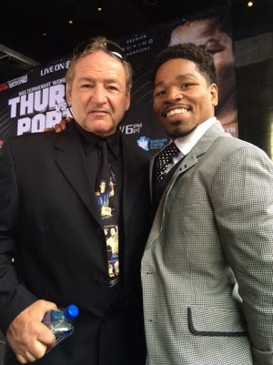 """Hal Chernoff with Shawn Porter. Porter will be a special guest at the """"Baddest Son-O-The-Beach Fight Fest"""" Friday evening."""
