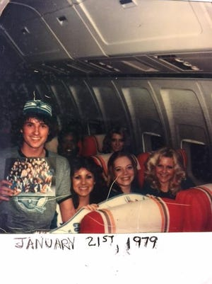 Bob Bliven of Rockledge has his picture taken with the Dallas Cowboys cheerleaders in an airplane after Super Bowl XIII.
