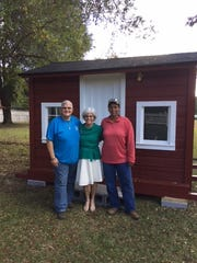 Candace with friends Amy, left, and Cindy on playhouse delivery day.
