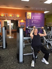 Terry Boothman using the machine shoulder press at