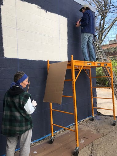Work begins on a mural created by artist Liz Rowse