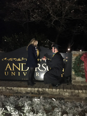 Cody Chavis, 23, proposes to his girlfriend Allie Castor, 20, after his graduation ceremony last December.