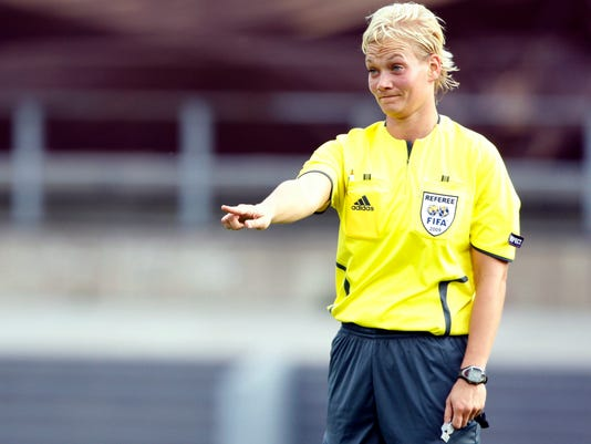 """FILE - In this Tuesday, Aug. 25, 2009 file photo, German referee Bibiana Steinhaus is seen during the first round Women's Euro 2009 soccer match between England and Italy in Lahti, Finland. Referee Bibiana Steinhaus has been promoted to the Bundesliga next season as the first women working games in Germany's top division. Steinhaus says she feels """"disbelief, delight, joy, relief, curiosity,"""" in an interview published on the Germany soccer federation's website on Friday, May 19, 2017. (AP Photo/Matthias Schrader, file)"""