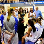 Thomas More coach Jeff Hans spends a timeout to help the Lady Saints regroup before they won their game on March 11.