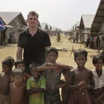 Actor Matt Dillon poses with Rohingya children at a camp for refugees, north of Sittwe in the western state of Rakhine, Myanmar.