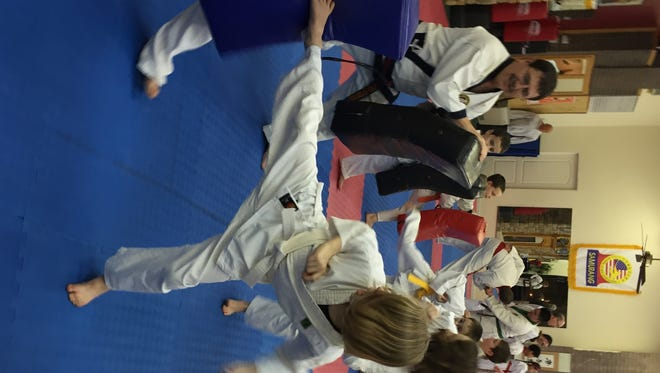 Students practice kicking drills during a Tang Soo Do class at Southern Tier Martial Arts in Endicott.
