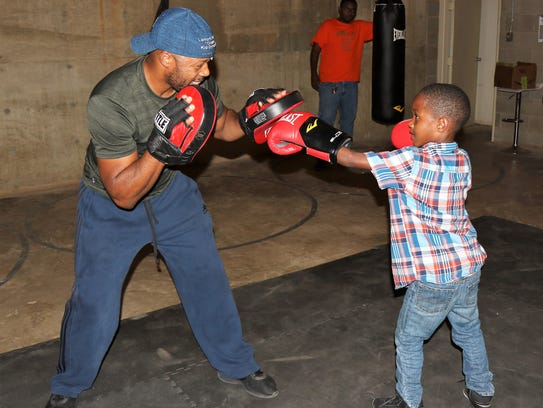 Lamont Ingram and Christopher Buckley practice boxing